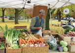 Dan Kent of Kent Family Growers at a farmers' market in NNY. Photo: courtesy of Kent Family