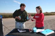 Lewis County dairy farmer Bernie Gohlert and NNYADP biocontrol nematode project intern Allyson Jones-Brimmer of Cornell prepare a biocontrol nematode application. Photo: NNYADP, Brian P. Whattam