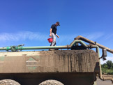 CCE Field Crops Specialist Mike Hunter loads biocontrol nematodes into liquid manure application tank.